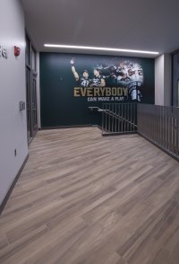 Future Spartans walk into the recruitment center on porcelain wood-look tile, installed with TEC® Full Flex®.