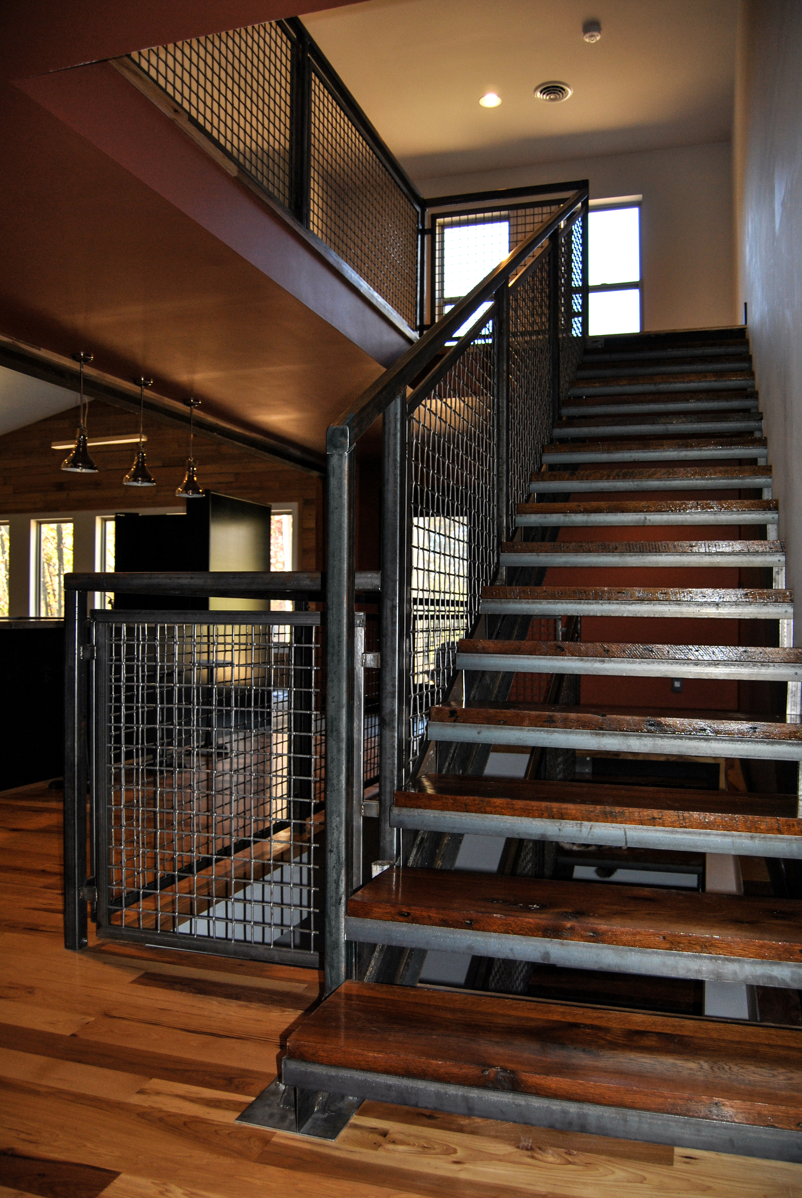 The Banker Wire Mesh And U Edge Frame Harmonize Visually With The Weathered  Steel Railing And Reclaimed Barn Wood Stair Treads